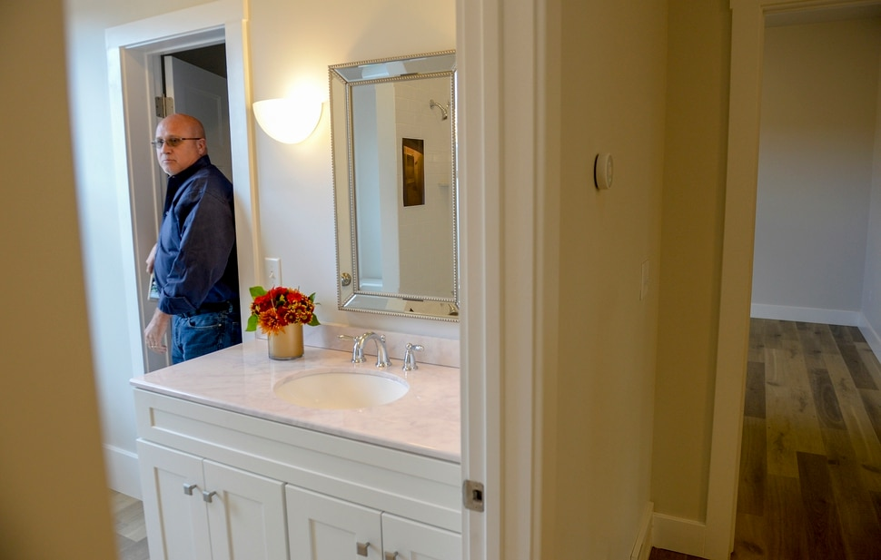 Leah Hogsten | The Salt Lake Tribune Visitors tour the Arctic Court historic home rehabilitation project during the celebratory open house with supporting project partners and community members. Preservation Utah and the Redevelopment Agency of Salt Lake City (RDA) held a ribbon cutting and a tour of the newly completed Preservation at Work Project Houseâ at 528 N. Arctic Court in Salt Lake City's historic Marmalade neighborhood, Thursday, October 11, 2018.