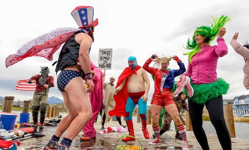 (Leah Hogsten | The Salt Lake Tribune) Regatta sailors break into moves during a dance contest at the annual Giant Pumpkin Regatta, October 19, 2019 on Oquirrh Lake in Daybreak, South Jordan.