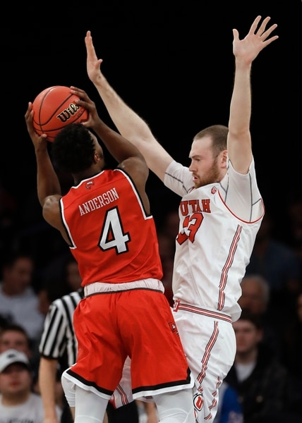 Western Kentucky guard Josh Anderson (4) shoots against Utah forward David Collette (13) during the first half of an NCAA college basketball game in the semifinals of the NIT, Tuesday, March 27, 2018, in New York. (AP Photo/Julie Jacobson)