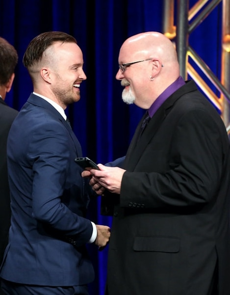 """(File photo courtesy of Getty Images) """"Breaking Bad"""" star Aaron Paul and TV critic Scott D. Pierce at the 2014 TCA Awards."""