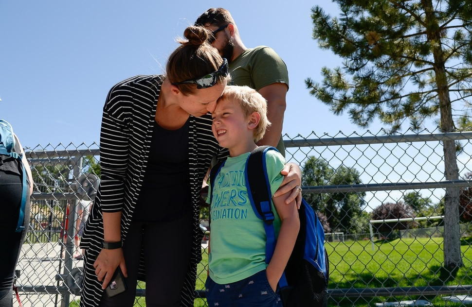 (Francisco Kjolseth | The Salt Lake Tribune) Lana Medina picks up her son Dylan, 5, following an exciting first day of kindergarten at Washington Elementary on Monday, Aug. 19, 2019.
