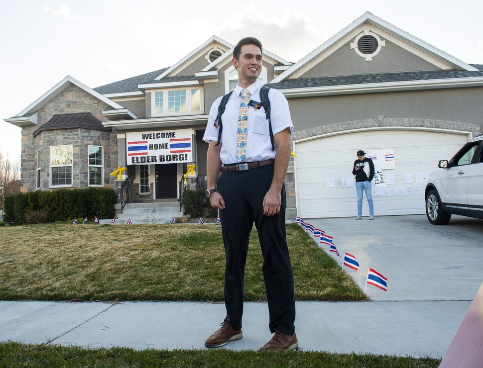 (Rick Egan   Tribune file photo) Elder Ethan Borg greets his friends and neighbors from a distance as he returns home from his Latter-day Saint mission in Thailand, Tuesday, March 24, 2020.