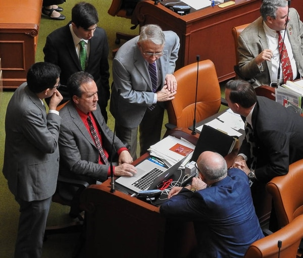 (Trent Nelson | The Salt Lake Tribune) Legislators and staff surround Rep. Brad Daw, R-Orem, after the House narrowly failed to pass HB197, which would have allowed the cultivation of marijuana. Salt Lake City, Friday, Feb. 9, 2018.