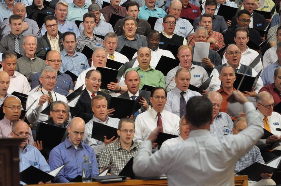 (Photo courtesy of The Church of Jesus Christ of Latter-day Saints) Luis A. Miranda Jr., second from left in second row from the bottom, and Utah Lt. Gov. Spencer Cox, fourth from left in the row behind Miranda, sing with the Mormon Tabernacle Choir and associate conductor Ryan Murphy during a rehearsal Oct. 26 in the Salt Lake Tabernacle. Miranda, the father of