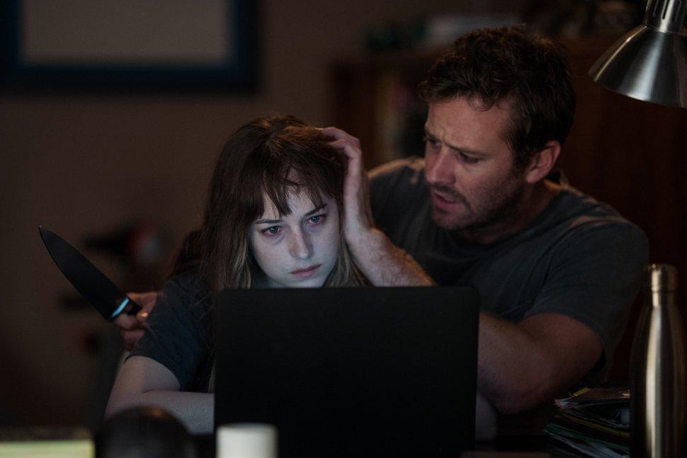 (Michele K Short | courtesy Sundance Institute) Dakota Johnson, left, and Armie Hammer star in Babak Anvari's horror thriller