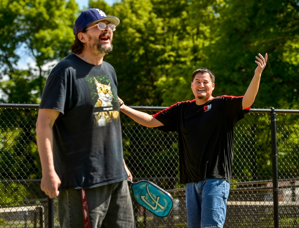 (Leah Hogsten | The Salt Lake Tribune) l-r Veterans Peter Gray and Dakoda Antelope share a laugh while playing pickleball at Hogan Park in Bountiful, May 14, 2019.