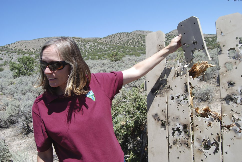 Brian Maffly | The Salt Lake Tribune Bekee Hotzee, who manages BLMÕs Salt Lake field office, examines plastic fencing target shooters leaned against a tree as a target.