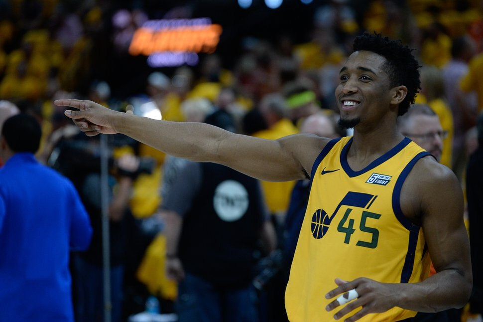 (Francisco Kjolseth | The Salt Lake Tribune) Utah Jazz guard Donovan Mitchell (45) jokes around with the team as they warm up for their game against the Houston Rockets in Game 4 of the NBA playoffs at the Vivint Smart Home Arena Sunday, May 6, 2018 in Salt Lake City.