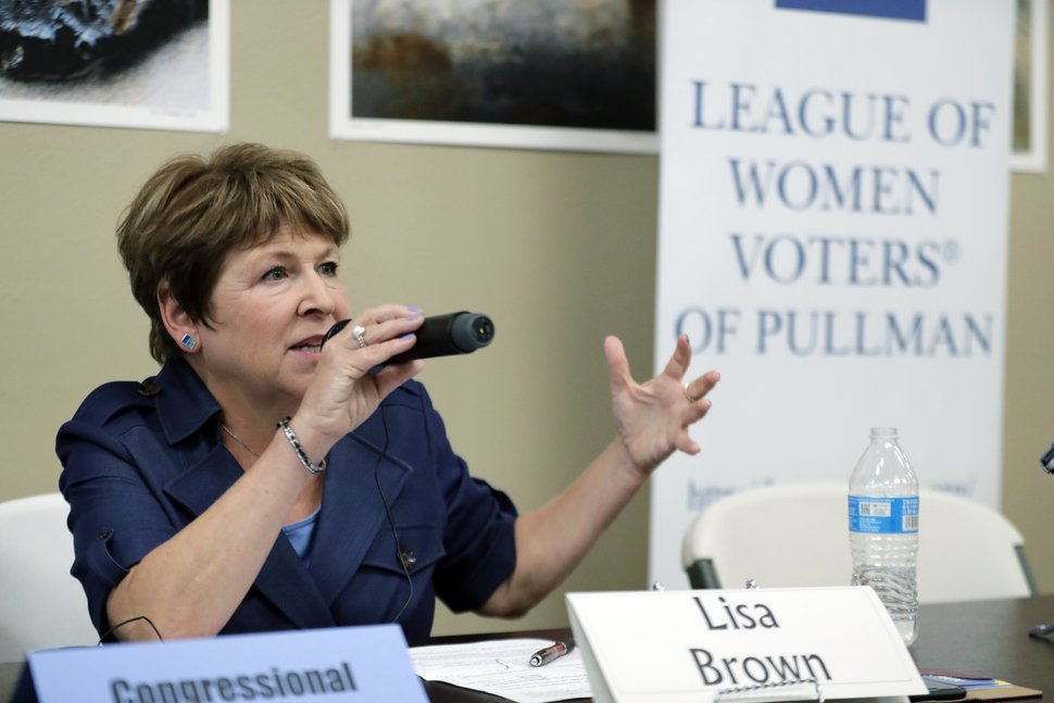 (Ted S. Warren | AP Photo) In this photo taken July 17, 2018, Lisa Brown, the presumed Democratic opponent to Republican U.S. Rep. Cathy McMorris Rodgers, speaks during a candidates forum in Colfax, Wash. McMorris Rodgers is sharply attacking Brown in the run-up to August's primary election.
