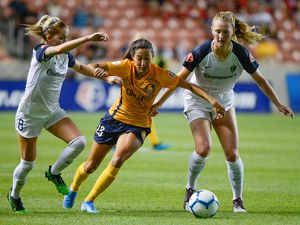 (Francisco Kjolseth  |  The Salt Lake Tribune)  Utah Royals FC forward Christen Press (23) gets pressured by North Carolina Courage midfielder Denise O'Sullivan (8) and North Carolina Courage midfielder Samantha Mewis (5) as Utah Royals FC hosts the North Carolina Courage at Rio Tinto Stadium in Sandy, Utah on Saturday, July 27, 2019.