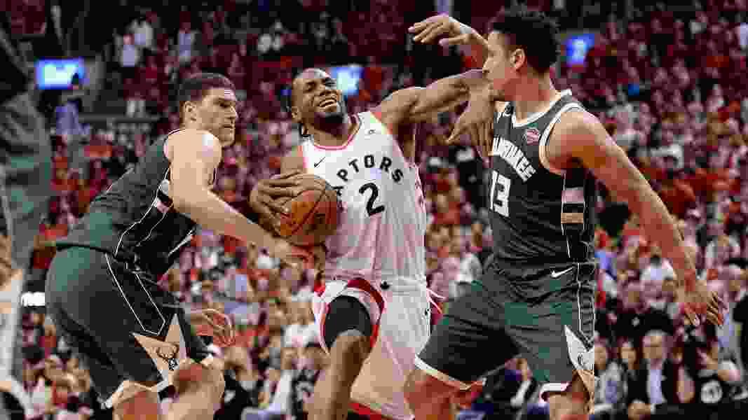 Kawhi Leonard scores 36, Raptors beat Bucks 118-112 in 2 OTs