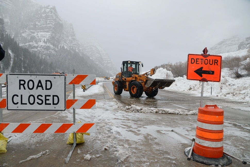 (Francisco Kjolseth | The Salt Lake Tribune) Heavy equipment crews work to clear Provo Canyon on Friday, Jan. 18, 2019, after an avalanche, which brought down as much as 30 feet of snow at mile marker 12 above Bridal Veil Falls on SR 189, was triggered by Utah Department of Transportation crews on Thursday. A side road next to Provo canyon was allowing cars through as they cleared the area knowns as Slide Canyon.