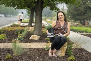 """(Leah Hogsten   The Salt Lake Tribune) """"I really believe in the program,"""" said Cindi Griwald with her son Collin, 21, who helped. """"It's the smartest thing to do. We're in a drought in a desert region."""" With the help of state-run rebate and incentive programs, Draper resident Griswald  thinks she got 80% of her money back to change her grass parking strips into a colorful, water-wise landscape, Aug. 6, 2021."""
