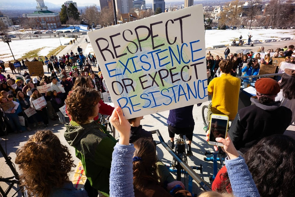Students gather to call for action on climate change at the Utah Capitol in Salt Lake City on Friday