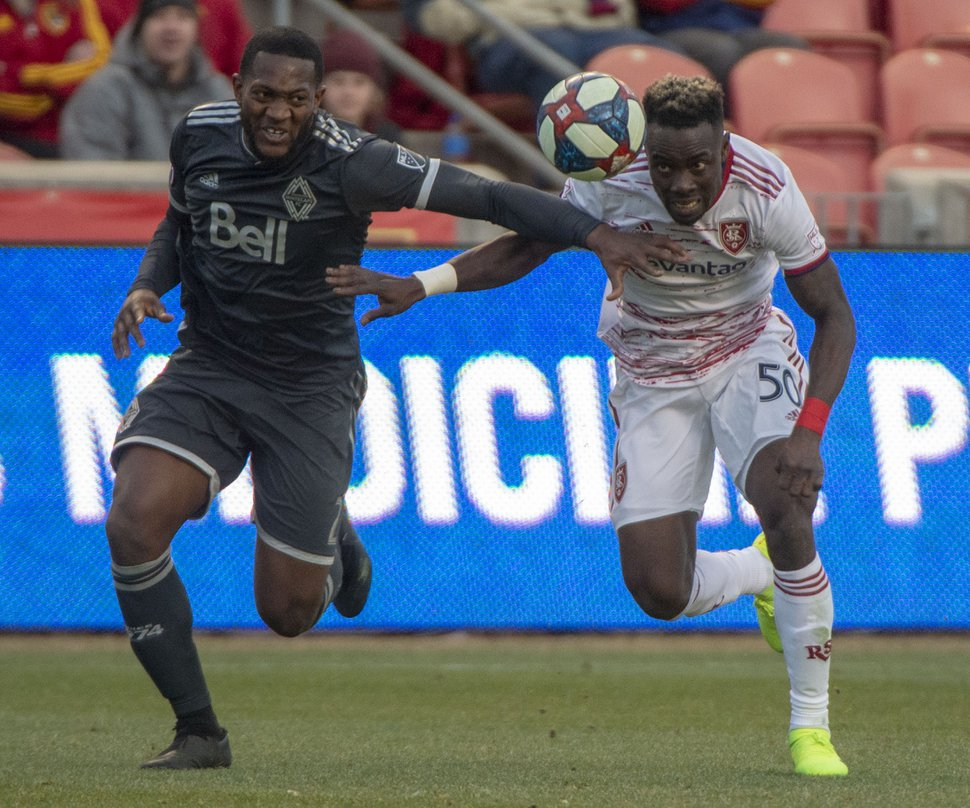 (Rick Egan   The Salt Lake Tribune) Vancouver Whitecaps defender Doneil Henry (2) goes for the ball along with Real Salt Lake forward Sam Johnson (50), in MLS soccer action at Rio Tinto Stadium in Sandy, Saturday, March 9, 2019.