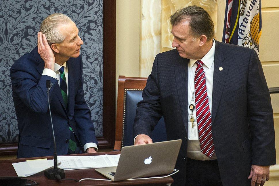 (Chris Detrick | Tribune file photo) Senate President Wayne L. Niederhauser, left, talks with Sen. Curt Bramble on the floor of the Utah Senate, March 9, 2017.