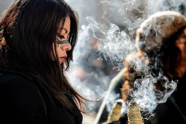 (Trent Nelson | The Salt Lake Tribune) Tania Ruiz burns sage before a short sit-in at the Wallace F. Bennett Federal Building in Salt Lake City Tuesday December 5, 2017, asking federal representatives to include a clean DREAM Act in the Omnibus Spending bill, or to vote against the Spending Bill should DACA protection not be included.