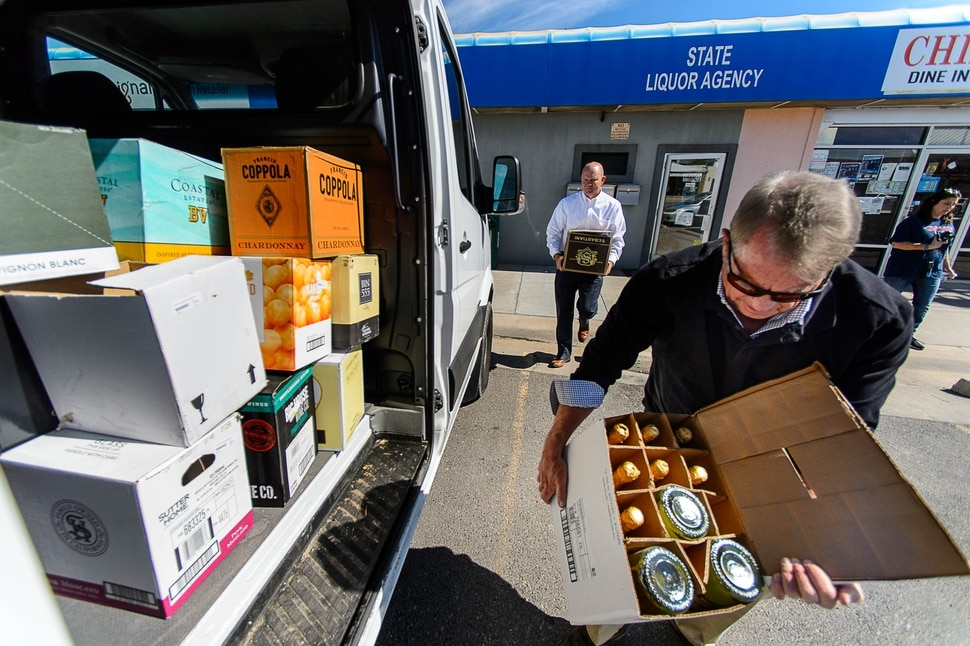 (Trent Nelson | The Salt Lake Tribune) DABC employees Tim Beardall and Terry Wood remove inventory from the package agency in Tremonton after routine audits showed a string of money losses and consumers lodged repeated complaints about stock availability, Tuesday, Sept. 26, 2017.