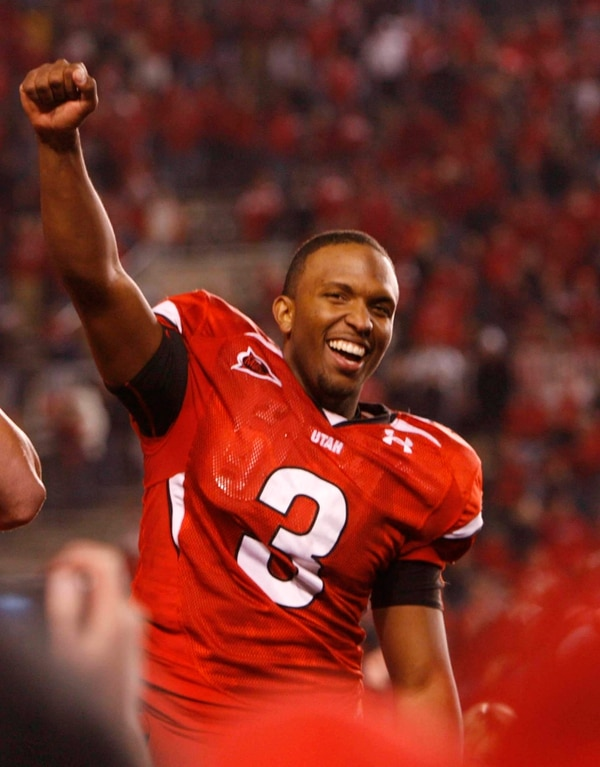 (Trent Nelson | Tribune file photo) Salt Lake City - Utah quarterback Brian Johnson (3) celebrates victory. Utah vs. BYU college football Saturday, November 22, 2008 at Rice-Eccles Stadium.