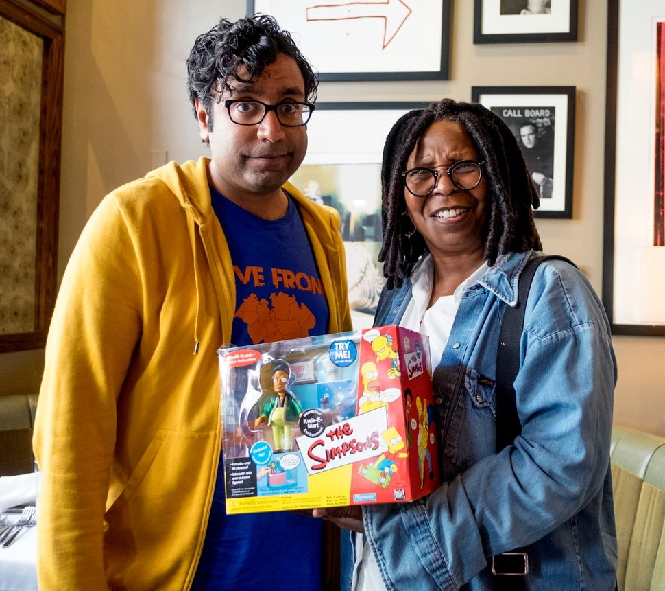 """(Photo courtesy David S. Holloway/truTV) Hari Kondabolu gives Whoopi Goldberg something for her """"negrobilia"""" collection, after she tells him that Apu would fit right in a racist minstrel show."""