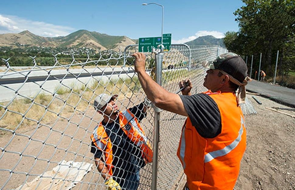 (Rick Egan | The Salt Lake Tribune) Alejandro Ocha and Ronie Ocha work on a chain-link fence along a new segment of Parley's Trail on Wednesday, Aug. 30, 2017.