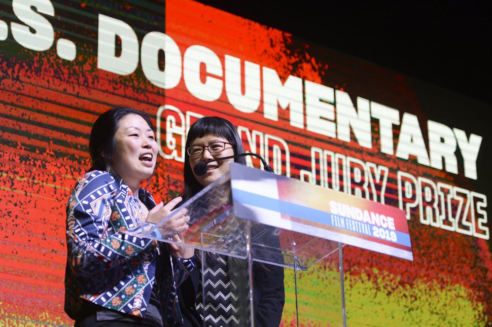 (Leah Hogsten | Tribune file photo) Jialing Zhang, left, accepts the Sundance U.S. Grand Jury Prize for her documentary