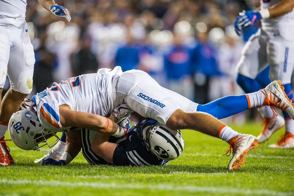 (Chris Detrick | The Salt Lake Tribune) Boise State Broncos linebacker Leighton Vander Esch (38) tackles Brigham Young Cougars wide receiver Talon Shumway (21) during the game LaVell Edwards Stadium Friday, October 6, 2017.