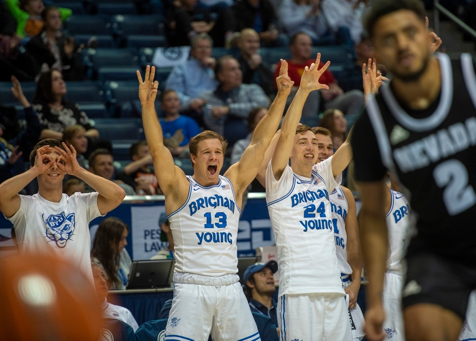 (Rick Egan | The Salt Lake Tribune) The Brigham Young bench reacts as the Cougars extend their lead after a 3-point shot late in the game, in basketball action between the Brigham Young Cougars and the Nevada Wolf Pack, at the Marriott Center, in Provo, Saturday, December 10, 2019.