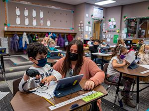 (Trent Nelson  |  The Salt Lake Tribune) Marci Weatherspoon works on a reading assignment with Lucas Gonzalez in her first grade class at Crescent Elementary in Sandy on Thursday, Dec. 10, 2020. Utah is no longer last in the nation for per-pupil spending, according to new data from U.S. Census.