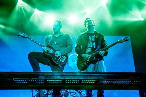 (Photo by Amy Harris/Invision/AP) Avenged Sevenfold guitarist Zacky Vengeance, left, said that while he has never had an official lesson and cannot tune his own guitar, bandmate Synyster Gates, right, is a highly technical performer well-versed in music theory.