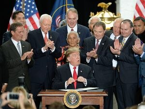 (Francisco Kjolseth | Tribune file photo) In this Dec. 4, 2017, file photo, President Donald Trump is surrounded by Utah leaders at the Utah Capitol, as well as then-San Juan County Commissioner Rebecca Benally (far left), as he signs the presidential proclamation to shrink Bears Ears national monument. San Juan County hired a law firm that paid several lobbyists to pressure then-Interior Secretary Ryan Zinke (center, top) and others in the Trump administration to make the cuts. Newly obtained emails show San Juan County's lobbying effort on Bears Ears.