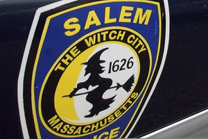 (Lisa Poole | AP file photo)  In this Dec. 26, 2003, photo, the logo for the Salem Police Department, which bears an image of a witch, is displayed on a police cruiser's door in Salem, Mass.