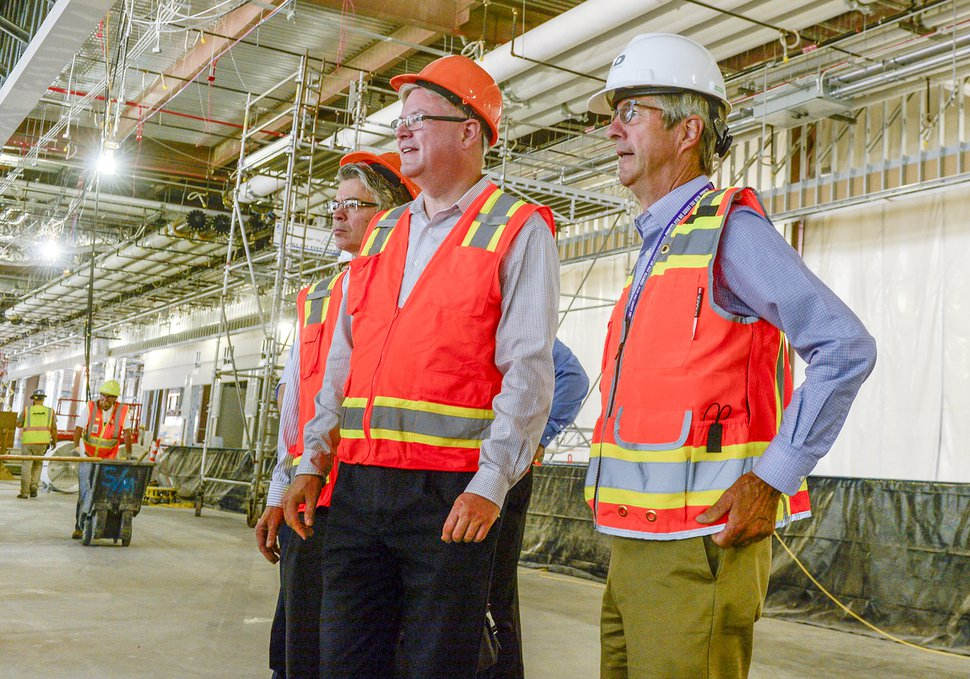 Leah Hogsten | The Salt Lake Tribune Bill Wyatt, Salt Lake City International Airport director (right), tours the airport expansion construction site, Wednesday, Aug. 1, 2018. The first phase construction of the $3.6 billion project is hitting the halfway mark — and large new buildings and elevated roadways are more easily seen. Nearing completion are the new concourse for aircraft gates, an enclosed terminal, the steel skeleton of a new