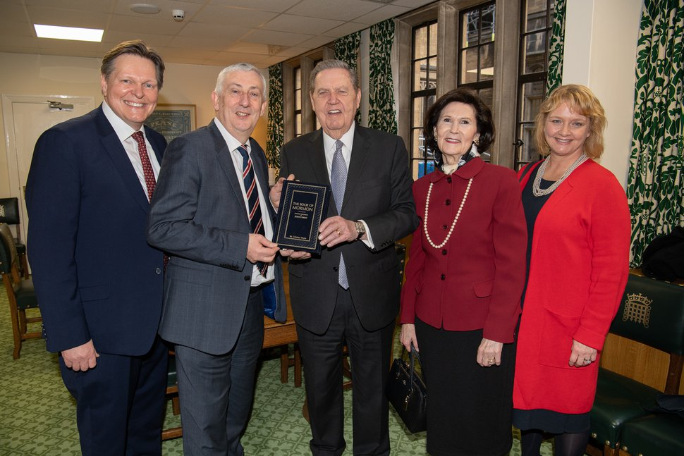 (Courtesy photo   The Church of Jesus Christ of Latter-day Saints) Apostle gives copies of the Book of Mormon at United Kingdom Parliament. Stephen Kerr MP, left; House of Commons Deputy Speaker, Rt. Hon. Sir Lindsay Hoyle MP; Elder Jeffrey R. Holland; sister Patricia T. Holland; and Yvonne Kerr.