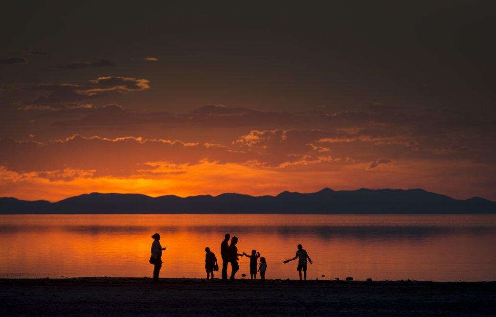 (Rick Egan | Tribune file photo) A family walks along the shore of the Great Salt Lake on Antelope Island, Monday, as seen on September 15, 2014.