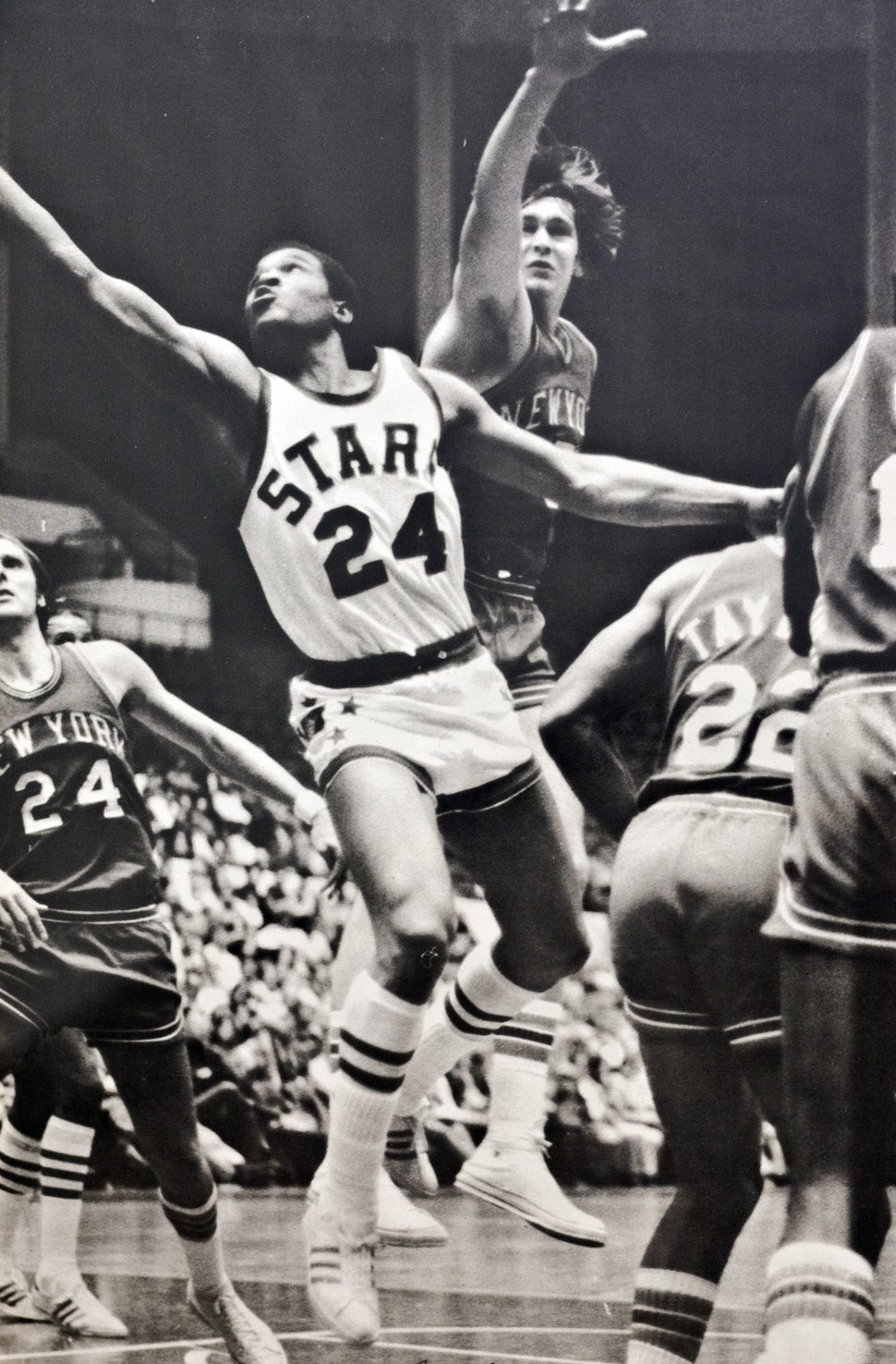 Photo courtesy of Mr. Mac | Utah Stars guard Ron Boone (25) lays the ball up in a crowd of New York Nets players during an ABA basketball game.