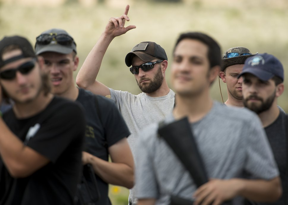 (Leah Hogsten | The Salt Lake Tribune) Cody Fitzgerald, 30, from Aurora, CO served as an E-4 in the Air Force and admitted that he has been thinking of joining the Special Forces team. Fitzgerald and other attendees learn about a AH-64 Apache Attack helicopter from the 211th Aviation Group during the Utah National Guard Special Forces Survival Training Experience, August 10-12 at Camp Williams.