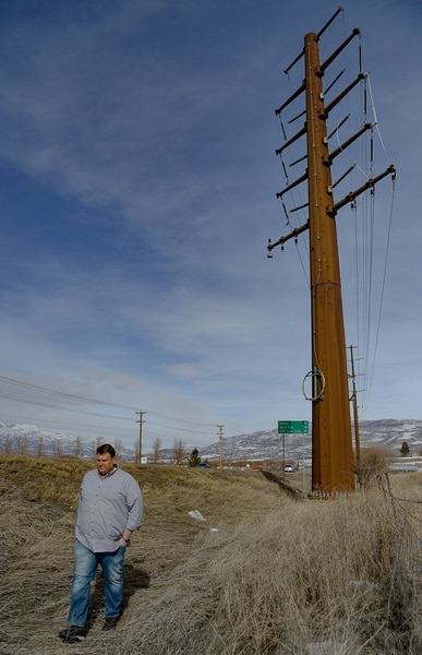 (Francisco Kjolseth | The Salt Lake Tribune) A large high powered dual 138-kV turn line power pole stands on the edge of Heber City as Midway residents, including Bengt Jonsson, talks about trying to convince Rocky Mountain Power to bury part of the transmission line the utility wants to build through the scenic Heber Valley town to the west. They are even willing to cover the cost, but the utility is challenging the town's requirement that the new line go underground.