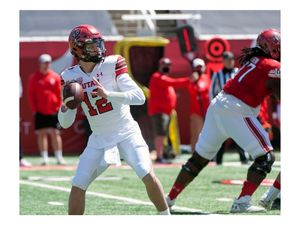 (Ed Kosmicki | Special to The Tribune) The red team QB Charlie Brewer #12 prepares to let a pass fly during the annual spring football game at the University of Utah, 17 April 2021.