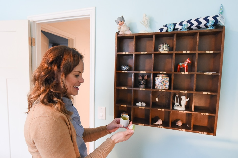 (Francisco Kjolseth | The Salt Lake Tribune) Blair Tomten, who has been using the Kondo method to tidy up her home in Millcreek, overlooks a shelf unit in the guest room that holds a number of sentimental items from her childhood.