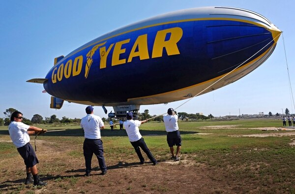 This Sept. 23, 2015 photo shows ground crew moring the Goodyear Blimp