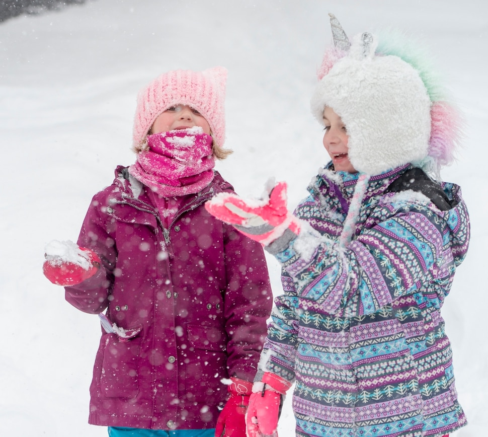 (Rick Egan | The Salt Lake Tribune) Second graders, Sarah Watt and Evelyn Oscarson play in the snow in the Avenues after school was cancelled because of the storm, Monday, Feb. 3, 2020.