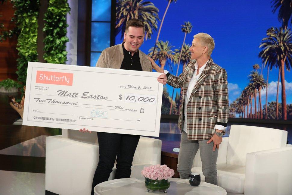 (Photo courtesy Michael Rozman/Warner Bros.) Talk show host Ellen DeGeneres presents Matthew Easton with a check for $10,000.