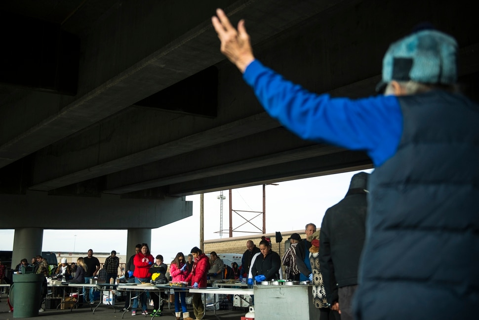 (Chris Detrick   The Salt Lake Tribune) Eagles Ranch Ministries founder Jennie Dudley prays before serving Thanksgiving Day meals during the Eagle Ranch Chuckwagon under the viaduct at 500 South and 600 West in Salt Lake City Thursday, November 23, 2017.