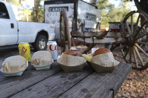 (Mark E. Bailey) Luke Fowles spent years working at fine dining establishments before transitioning to his current mobile format. The Capitol Burger truck is based in Torrey.