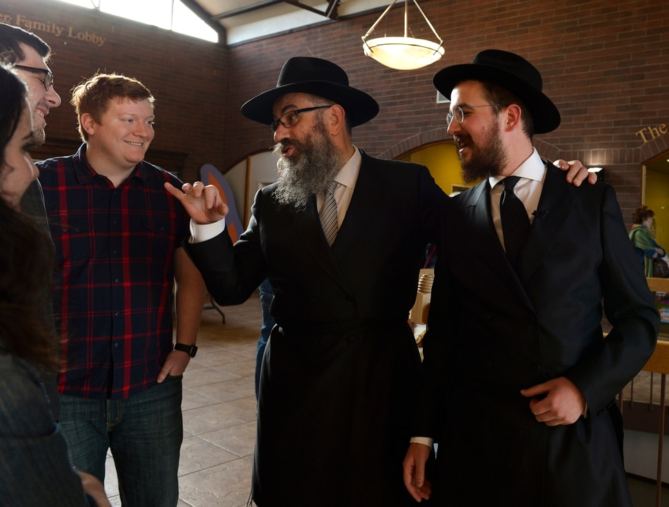 Leah Hogsten | The Salt Lake Tribune l-r Rabbi Benny Zippel and Rabbi Avremi Zippel share a moment with congregants prior to the Shabbat candle lighting. Jewish women in Utah at the Chabad Lubavitch of Utah and the world over kindled Shabbat candles, May 3, 2019 in loving tribute to Lori Gilbert-Kaye and in prayer for peace and tolerance amongst all of humanity. Lori Kaye was killed during The Chabad of Poway synagogue shooting on the last day of Passover and three others were injured. Although the lighting of Shabbat Candles is uniquely tasked to the Jewish woman, the community and those wishing to show their support were welcome to attend.