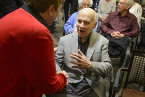 (Steve Griffin  |  The Salt Lake Tribune) Paul Christensen visits with some of his former students following a Christmas concert at Cottonwood Place senior living community in Holladay Friday December 15, 2017. During the concert the Salt Lake Education Foundation presented a new scholarship in his honor. For 30 years, Christensen inspired generations of students at Highland High School to pursue their musical talents as the lively choral director of the school's many music programs.