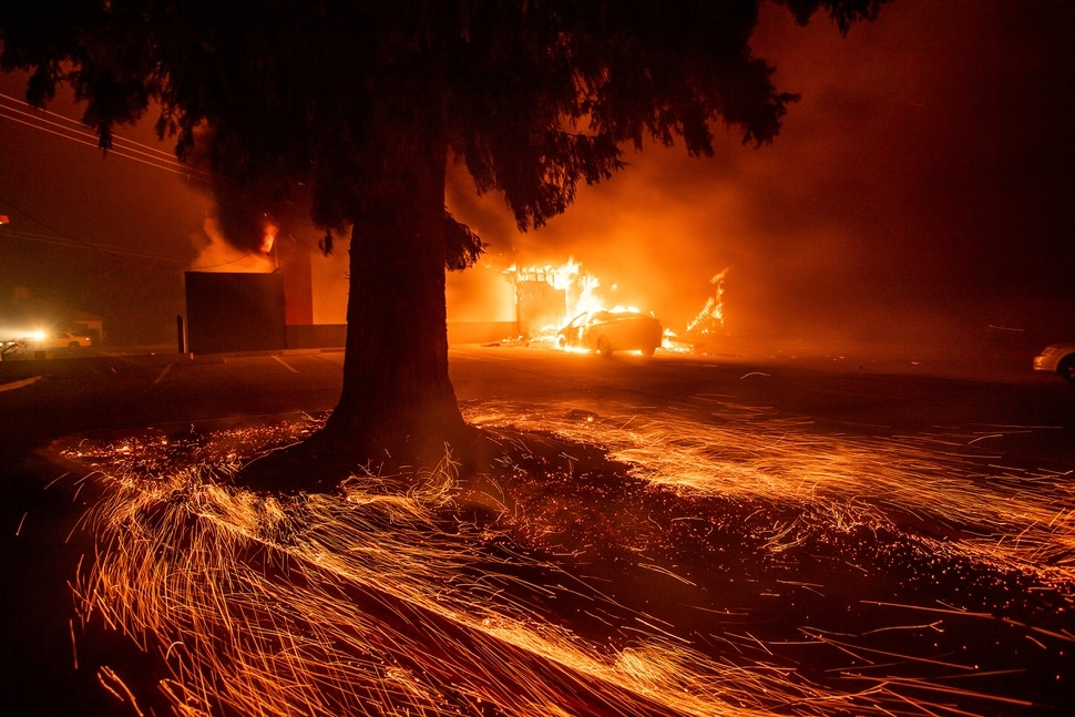 (Noah Berger | The Associated Press) Flames consume a Kentucky Fried Chicken as the Camp Fire tears through Paradise, Calif., on Thursday, Nov. 8, 2018. Tens of thousands of people fled a fast-moving wildfire Thursday in Northern California, some clutching babies and pets as they abandoned vehicles and struck out on foot ahead of the flames that forced the evacuation of an entire town and destroyed hundreds of structures.
