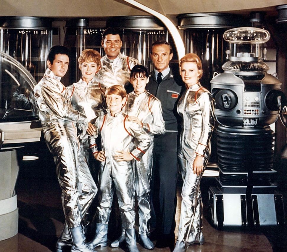 """(Photo courtesy of CBS) Mark Goddard as Don West, June Lockhart as Maureen Robinson, Guy Williams as John Robinson, Billy Mumy as Will Robinson, Angela Cartwright as Penny Robinson, Jonathan Harris as Dr. Smith, Marta Kristen as Judy Robinson, and the Robot in the original """"Lost in Space."""""""
