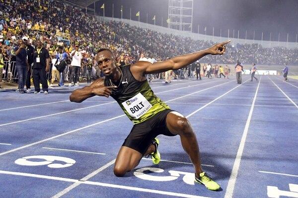 Jamaica's Usain Bolt celebrates after winning the